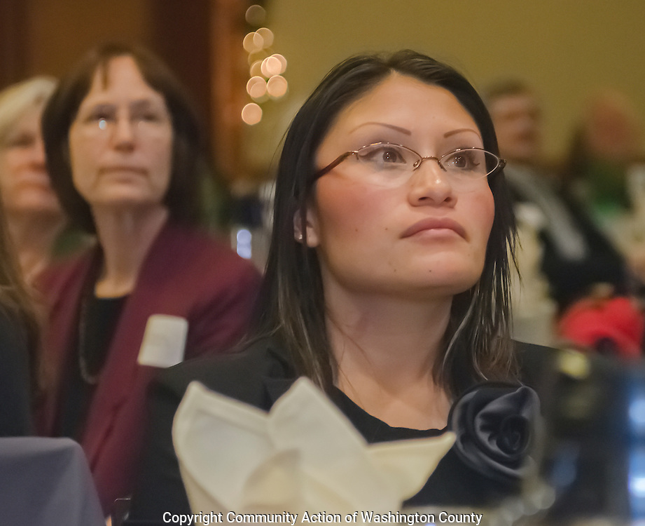 Participant at annual social service fundraising breakfast.
