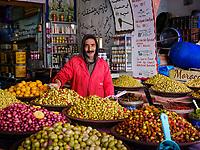 CASABLANCA, MOROCCO - CIRCA APRIL 2018: Merchant at The Great Habous Olive Market in Casablanca.