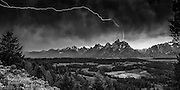 Lightning bolt hitting Teewinot and spreading across the Grand Teton valley floor in Jackson Hole, WY. This is a split second capture by Mike R. Jackson