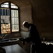 Father Sacristan cleans an incense burner after Mass. Solesmes on 18-10-19<br /> Le père sacristain nettoie un encensoir après la messe. Solesmes le 18-10-19