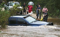 August 27, 2017 - Seguin, Texas, U.S. - Residents attempt in vain to tether their truck in floodwaters just off Highway 21 near Cedar Creek, as Hurricane Harvey hits the countryside east of San Antonio. (Credit Image: © Tom Reel/San Antonio Express-News via ZUMA Wire)