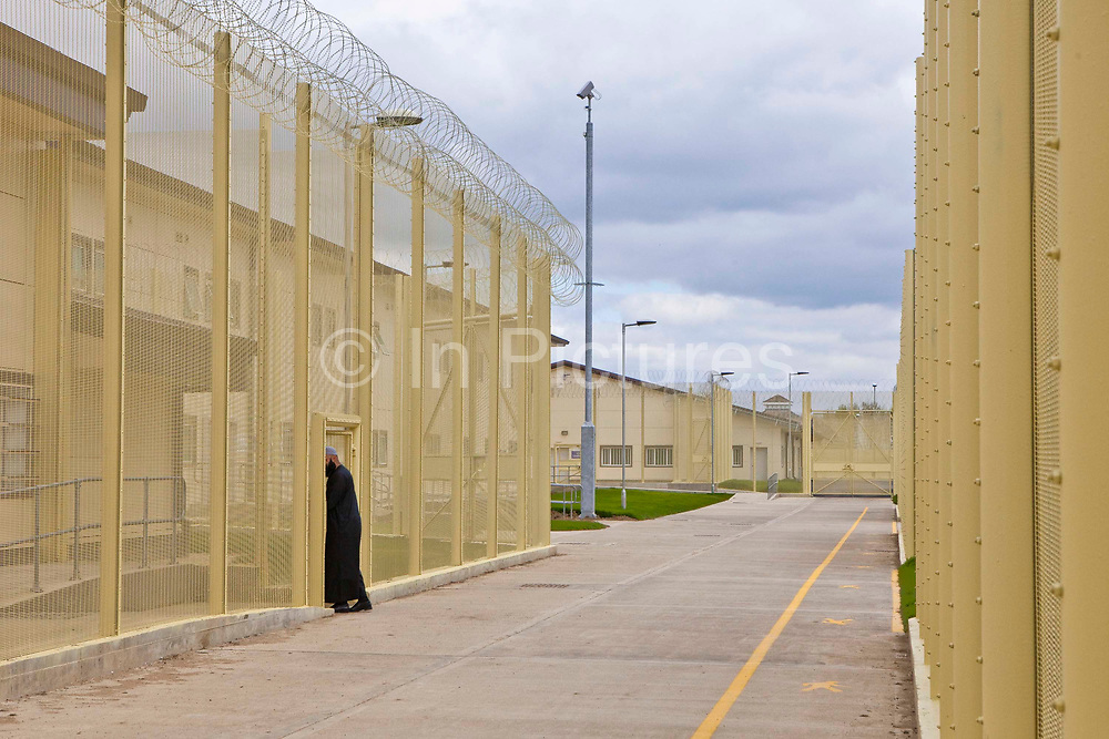 The prison Imam entering the mosque area at HMP & YOI Littlehey. Littlehey is a purpose build category C prison.