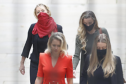 © Licensed to London News Pictures. 13/07/2020. London, UK. American actor AMBER HEARD arrives at the High Court in London where Johnny Depp he is in a legal dispute with UK tabloid newspaper The Sun over allegations he assaulted his former wife, Amber Heard. Photo credit: Peter Macdiarmid/LNP