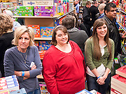 "09 DECEMBER 2010 - PHOENIX, AZ: People in line at the Barnes & Noble Bookstore in Phoenix, AZ, Thursday, Dec. 9, wait to get signed books by George W. Bush. More than 2,000 people lined up starting at 5AM to get copies of the former President's book, ""Decision Points."" A handful of protesters demonstrated against President Bush near the bookstore, calling him a ""war criminal.""  PHOTO BY JACK KURTZ"