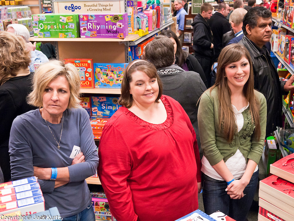 """09 DECEMBER 2010 - PHOENIX, AZ: People in line at the Barnes & Noble Bookstore in Phoenix, AZ, Thursday, Dec. 9, wait to get signed books by George W. Bush. More than 2,000 people lined up starting at 5AM to get copies of the former President's book, """"Decision Points."""" A handful of protesters demonstrated against President Bush near the bookstore, calling him a """"war criminal.""""  PHOTO BY JACK KURTZ"""