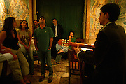"""Camane is one of the most acclaimed singers from the new generation. Here he is participating in an unformal session at restaurant """"Mesa de Frades"""", an old chapel in Alfama typical neighborhood"""