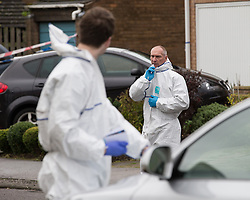 © Licensed to London News Pictures . 23/10/2014 . Penistone , UK . Police and forensic examiners at the scene . A fire in a house on Tennyson Close in Penistone near Barnsley has killed a nine year old boy and a 44 year old man and a boy aged 11 is critically ill in hospital . The house is cordoned off by police . Photo credit : Joel Goodman/LNP