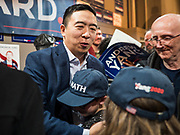 12 DECEMBER 2019 - DES MOINES, IOWA: ANDREW YANG hugs a young supporter during the opening of his campaign office in Ames, IA. Yang, an entrepreneur, is running for the Democratic nomination for the US Presidency in 2020. He brought bus tour to Ames, IA, Thursday. Iowa hosts the the first election event of the presidential election cycle. The Iowa Caucuses will be on Feb. 3, 2020.       PHOTO BY JACK KURTZ
