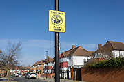 A Neighbourhood Watch sign high up on a pole in a residential suburban street in the borough of Southwark, on 24th February 2018, in south London, England.
