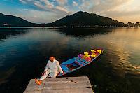 A merchant and his shikara (boat) loaded with flowers, Dal Lake in Srinagar, Kashmir, Jammu and Kashmir State, India.