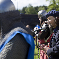 """Poet and Guardians trustee, Paraig MacNeil, speaks to the crowd.<br /> <br /> <br /> BRAVEHEART HEROES, WILLIAM WALLACE AND ANDREW DE MORAY, FINALLY HONOURED AT STIRLING BRIDGE BATTLE SITE AS SALTIRE RAISED FOR FIRST TIME IN OVER 700 YEARS<br /> <br /> Friday 29th May, 2015<br /> <br /> IT'S TAKEN more than 700 years but today, the two heroes at the centre of one of the most important battles in Scottish history have been jointly honoured at the spot where they both led an outnumbered Scottish army to victory against the English.<br /> The formal unveiling ceremony at Stirling Bridge today (Friday 29th May), of three lecterns made of traditional Scottish whinstone dedicated to the memory of William Wallace and Andrew de Moray,at site of the historic victory at Battle of Stirling Bridge.<br /> At a special ceremony attended by Andrew de Moray's direct descendant, the Earl of Moray, and Stewart Maxwell, MSP, convener of the Scottish Parliament's Education and Culture Committee, the memorials were formally unveiled.Mr Maxwell opened the event and after the dedication, together with the Earl of Moray, they raised the Saltire together at the site of the Battle of Stirling Bridge. This is the first time in over 700 years that the Saltire has flown at Stirling Bridge. The flag will now become a permanent fixture at the site of the Battle.<br /> John Stuart, the current Earl of Moray, said of his illustrious kinsman: """"I am delighted that Andrew de Moray is finally, after 700 years, to have the recognition he deserves. The Guardians of Scotland have put a huge amount of time and effort into the lecterns, which are a very fitting tribute to one of Scotland's greatest patriots.""""<br /> The victory represented a key moment in the Scottish Wars of Independence. Eminent Scots historian, Sir Tom Devine, recently described the battle as being 'second in importance only to Bannockburn in the Wars of Independence'.<br /> It is the first time the two men have been given equal prominenc"""