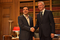 June 12, 2017 - Athens, Attiki, Greece - Handshake between Greek Prime Minister Alexis Tsipras (left) and of France's Finance Minister Bruno Le Maire. (Credit Image: © Dimitrios Karvountzis/Pacific Press via ZUMA Wire)