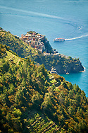 Ferry arriving at Fishing village and harbour of Riomaggiore, Cinque Terre National Park, Liguria, Italy