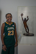 April 2, 2016; Indianapolis, Ind.; Kiki Robertson poses with a statue of her great-great uncle, Oscar Robertson, before the team's green screen session at the NCAA Headquarters.