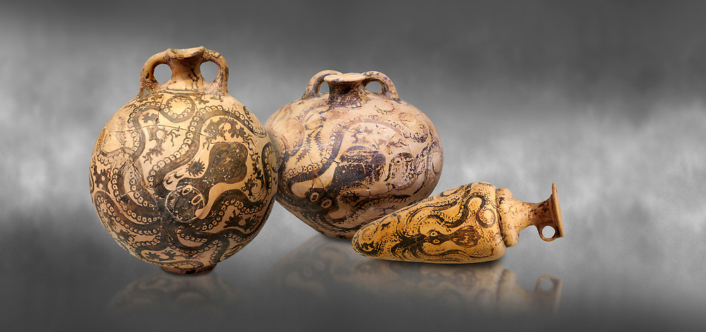 Minoan pottery with stylised octopus decorations, 1500-1400 BC, Heraklion Archaeological Museum , grey background.  <br /> <br /> From Left to right<br /> 1- flask with Marine style stylised octopus design,   Palaikastro,  1500-1450 BC; <br /> 2.Minoan clay flask with octopus design, Speial Palatial Style , Pseira  1500-1400 BC BC, <br /> 3- conical rhython with Marine style stylised octopus design,   Palaikastro 1500-1450 BC; .<br /> <br /> If you prefer to buy from our ALAMY PHOTO LIBRARY  Collection visit : https://www.alamy.com/portfolio/paul-williams-funkystock/minoan-art-artefacts.html . Type -   Heraklion   - into the LOWER SEARCH WITHIN GALLERY box. Refine search by adding background colour, place, museum etc<br /> <br /> Visit our MINOAN ART PHOTO COLLECTIONS for more photos to download  as wall art prints https://funkystock.photoshelter.com/gallery-collection/Ancient-Minoans-Art-Artefacts-Antiquities-Historic-Places-Pictures-Images-of/C0000ricT2SU_M9w