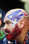 A New England Patriots fan with a shaved head sports a red beard and a team logo painted on his head during the NFL Super Bowl XLIX football game against the Seattle Seahawks on Sunday, Feb. 1, 2015 in Glendale, Ariz. The Patriots won the game 28-24. ©Paul Anthony Spinelli