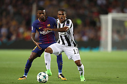 September 12, 2017 - Barcelona, Spain - Douglas Costa of Juventus controls the ball under pressure from Nelson Semedo of FC Barcelona during the UEFA Champions League, Group D football match between FC Barcelona and Juventus FC on September 12, 2017 at Camp Nou stadium in Barcelona, Spain. (Credit Image: © Manuel Blondeau via ZUMA Wire)