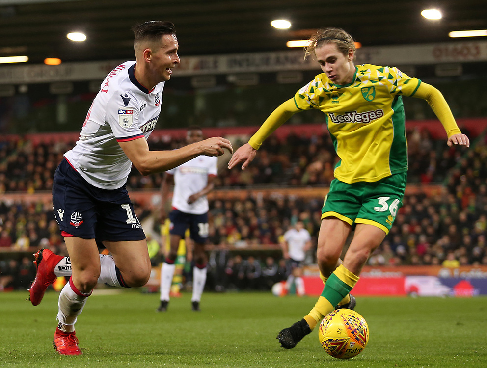 Bolton Wanderers' Pawel Olkowski gets away from Norwich City's Todd Cantwell<br /> <br /> Photographer David Shipman/CameraSport<br /> <br /> The EFL Sky Bet Championship - Norwich City v Bolton Wanderers - Saturday 8th December 2018 - Carrow Road - Norwich<br /> <br /> World Copyright © 2018 CameraSport. All rights reserved. 43 Linden Ave. Countesthorpe. Leicester. England. LE8 5PG - Tel: +44 (0) 116 277 4147 - admin@camerasport.com - www.camerasport.com