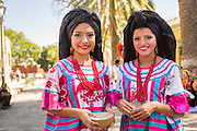 Traditional costumed Zapotec maidens smile October 26, 2014 in Oaxaca, Mexico.