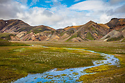 Landmannalaugar is a place in the Fjallabak Nature Reserve in the Highlands of Iceland. It is at the edge of Laugahraun lava field, which was formed in an eruption around the year 1477. It is known for its natural geothermal hot springs and surrounding landscape.