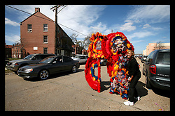 Feb 28th, 2006. New Orleans, Louisiana. Mardi Gras Day, Fat Tuesday. Mardi Gras Indian. Ernest Hingle Junior, a flag boy for the Yellow Pokahontas (spell check) tribe prepares to join other Mardi indians for the days festivities. Many of the Mardi Gras Indians lost everything to hurricane Katrina. Ernest gets ready in the old Iberville housing projects.