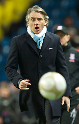 MANCHESTER, ENGLAND - Sunday, February 13, 2010: Manchester City's manager Roberto Mancini kicks the ball on the pitch during the FA Cup 5th Round match against Stoke City at the City of Manchester Stadium. (Photo by David Rawcliffe/Propaganda)  MANCHESTER, ENGLAND - Sunday, February 13, 2010: Manchester City xxxx and Stoke City's xxxx during the FA Cup 5th Round match at the City of Manchester Stadium. (Photo by David Rawcliffe/Propaganda)