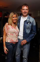 """JOHN LESLIE and ANGELA STEWART at a party to celebrate the publication of a """"Diary of A C List Celebrity"""" by Paul Hendy held at Bar 19/21 Soho House, 21 Old Compton Street, London W1 on 13th July 2004."""