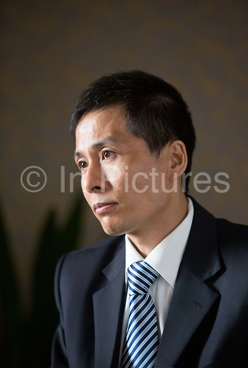 Zhu Ruifeng, self-made citizen journalist and corruption fighter who became nationally know after he revealed sex tapes of high ranking Chongqing government officials, photographed in Beijing, China on 20 February  2013.