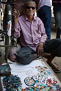 A man trading gemstones on the streets of the Johari bazaar, Jaipur, India