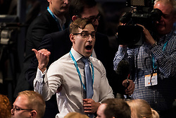 © Licensed to London News Pictures. 04/10/2017. Manchester, UK. A protestor is removed from the hall   during a speech by British prime minister THERESA MAY on the final day of the Conservative Party Conference. The four day event is expected to focus heavily on Brexit, with the British prime minister hoping to dampen rumours of a leadership challenge. Photo credit: Ben Cawthra/LNP