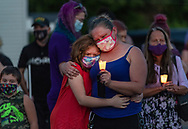 """Isis Slawoniewski, 11, and her mother Stephanie Slawoniewski of Canastota, attend a candlelight vigil in honor of 19 year old Elizabeth """"Lizzy"""" Garrow on Sunday, Sept. 27, 2020, in Canastota, N.Y. Garrow was last seen Sept. 23, 2020. A body of a young woman, believed to be that of Garrow was found in Canastota this morning."""