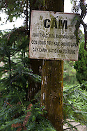A sign warns community that it's strictly forbidden to exchange, buy or sell dried animals, living animals, orchids, bonsaï, or any other wild animal species from the forest, in Tam Dao National Park.