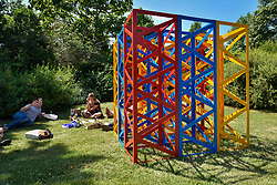 """© Licensed to London News Pictures. 05/07/2017. London, UK. """"Summertime - The Regents Park"""", 2017, by Rasheed Araeen.  The Frieze Sculpture festival opens to the public in Regent's Park.  Featuring outdoor works by leading artists from around the world the sculptures are on display from 5 July to 8 October 2017.  Photo credit : Stephen Chung/LNP"""