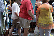 obese person with a walking cane