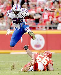 Nov 26, 2017; Kansas City, MO, USA; Buffalo Bills running back LeSean McCoy (25) leaps over Kansas City Chiefs inside linebacker Derrick Johnson (56) on a run during the first half at Arrowhead Stadium. Mandatory Credit: Denny Medley-USA TODAY Sports