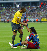 Photo: Chris Ratcliffe.<br /> Arsenal v Barcelona. UEFA Champions League Final. 17/05/2006.<br /> Thierry Henry offers to help up Ronaldinho.
