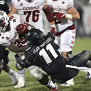 ORLANDO, FL - NOVEMBER 14: Jeremiah Jean-Baptiste #11 of the Central Florida Knights tackles Tayvon Ruley #29 of the Temple Owls at Bounce House-FBC Mortgage Field on November 14, 2020 in Orlando, Florida. (Photo by Alex Menendez/Getty Images) *** Local Caption *** Jeremiah Jean-Baptiste; Tayvon Ruley