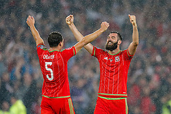 James Chester (Hull City) and Joe Ledley (Crystal Palace) after Wales win the match 1-0 to top their UEFA2016 Qualifying Group - Photo mandatory by-line: Rogan Thomson/JMP - 07966 386802 - 12/06/2015 - SPORT - FOOTBALL - Cardiff, Wales - Cardiff City Stadium - Wales v Belgium - EURO 2016 Qualifier.