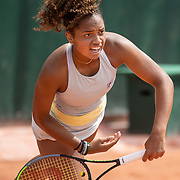 PARIS, FRANCE June 10. Robin Montgomery of the United States in action against Diana Shnaider of Russia in the quarter finals of the Junior Singles competition singles competition at the 2021 French Open Tennis Tournament at Roland Garros on June 10th 2021 in Paris, France. (Photo by Tim Clayton/Corbis via Getty Images)