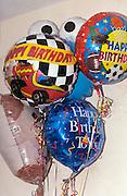 Bunch of inflated birthday balloons.  Brooklyn Center  Minnesota USA