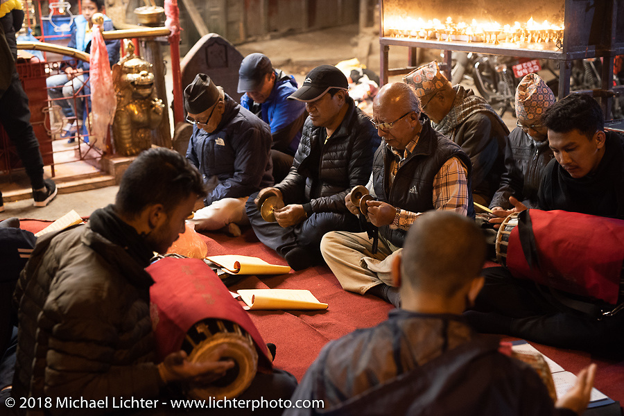 A group of men singing as their religious devotion in the Thamel district of Kathmandu after our Himalayan motorcycling adventure, Nepal. Friday, November 16, 2018. Photography ©2018 Michael Lichter.