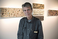 Renowned Dutch artist Bob van Persie, photographed in front of his pictures at the Richard Goodall Gallery in Manchester, where his latest exhibition is about to open. Bob van Persie is the father of the Manchester United and Netherlands footballer Robin. The show, entitled 'One Man - Full House,' was due to open on 12th September and continue until 5th October.