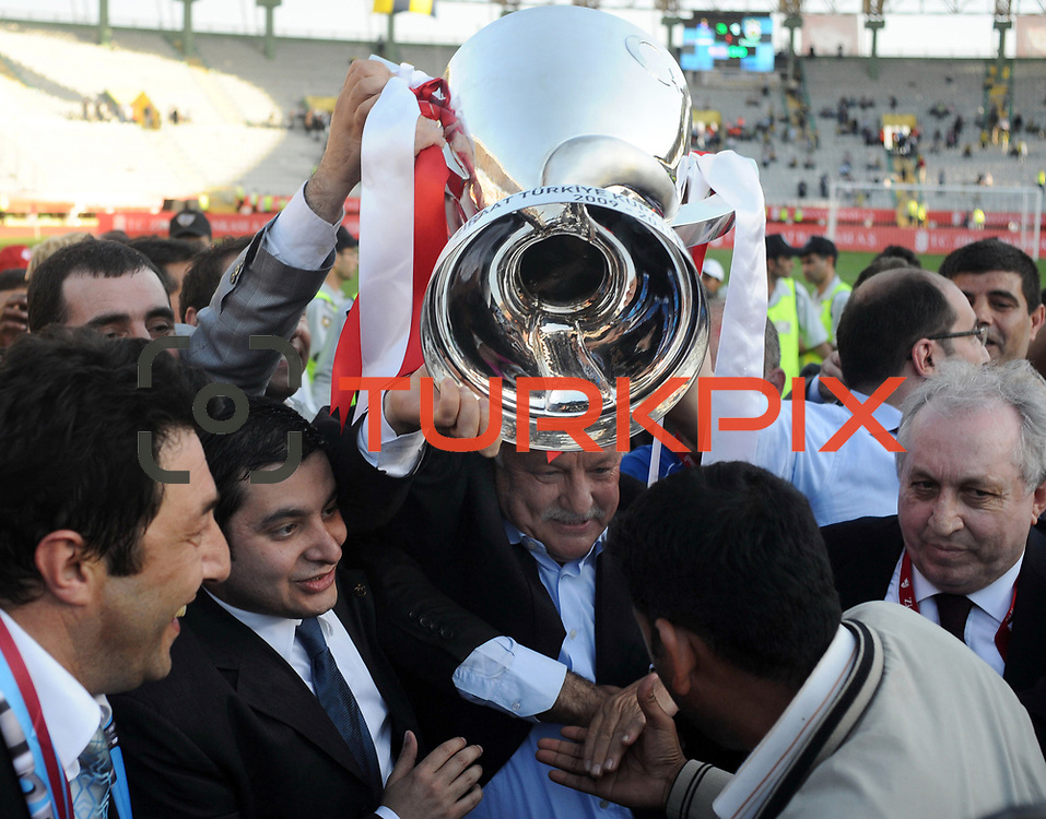 Jubilant Trabzonspor's president Sadri SENER (C) lifting up the cup at the ceremony during their after the Turkey Cup final match Trabzonspor between Fenerbahce at the GAP Arena Stadium at Urfa Turkey on wednesday, 05 May 2010. Photo by TURKPIX