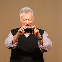 US Actor John de Lancie takes a photo of the audience during a meeting with his fans in Budapest, Hungary on January 11, 2015. ATTILA VOLGYI