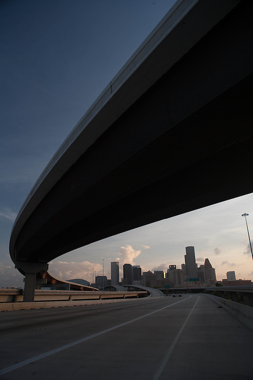 Houston, Texas skyline viewed from a northbound freeway in early evening.