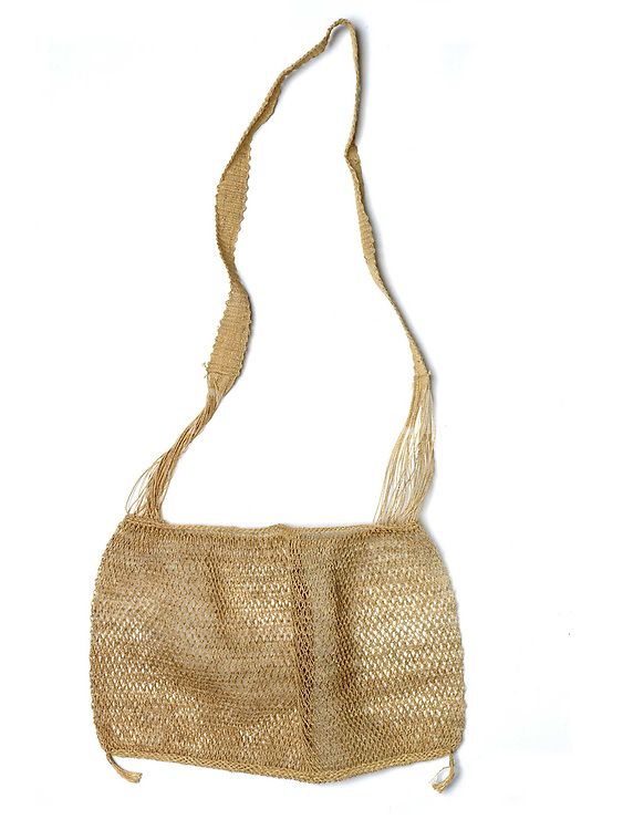 A traditional Khmu bag made from Liana 'jungle' vine. Khmu women twist Liana vine to make into a strong fibre for 'crocheting' into a traditional bag used by men and women for carrying items to and from the fields. Liana vine or 'piat' in Lao, is harvested from the forest, although these days it is becoming more difficult to find and many woman now use colourful synthetic thread.