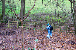 "© Licensed to London News Pictures. 07/12/2019. Gerrards Cross, UK. A Forensic investigator takes a photograph inside a cordoned area as London's Metropolitan Police Service searches woodland in Gerrards Cross, Buckinghamshire. Police have been in the area conducting operations since Thursday 5th December 2019 and are searching two areas on Hedgerley Lane. In a press statement a Metropolitan Police spokesperson said ""Officers are currently in the Gerrards Cross area of Buckinghamshire as part of an ongoing investigation.<br /> ""We are not prepared to discuss further for operational reasons.""<br /> Photo credit: Peter Manning/LNP"