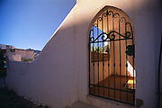 An elegant metal gate leads into a private home in Ponza, Italy