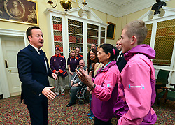 © Licensed to London News Pictures. 28/11/2012. Westminster, UK British Prime Minister David Cameron meets recipients of the Big Society awards in Downing Street this evening 28 November 2012. The Big Society Awards were set up by the Prime Minister in November 2010. Twelve winners are decided each quarter and then announced once a week throughout the year. Winners receive an invitation to a reception at No.10 Downing Street and get the chance to attend a practical networking and support event earlier in the day.  They also receive a plaque and signed certificate from the Prime Minister. Photo credit : Stephen Simpson/LNP