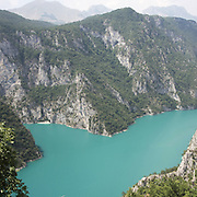 """Scutari lake. There are several arguments about the derivation of the name  """"Montenegro"""", one of these relates to dark and deep forests  that once covered the Dinaric Alps, as it was possible to see them from the sea. <br /> Mostly mountainous with 672180 habitants on an area of 13812 Km², with a population density of  48 habitants/Km². <br /> It borders with Bosnia, Serbia, Croatia, Kosovo and Albania but  Montenegro has always been alien to the bloody political events that characterized Eastern Europe in recent decades. <br /> From 3 June 2006, breaking away from Serbia, Montenegro became an independent state. <br /> In the balance between economy devoted to sheep farming and a shy tourist, mostly coming from Bosnia and Herzegovina, Montenegro looks to Europe with a largely unspoiled natural beauty. <br /> Several cities in Montenegro, as well as the park Durmitor, considered World Heritage by UNESCO but not yet officially because Montenegro has yet to ratify the World Heritage Convention of UNESCO."""
